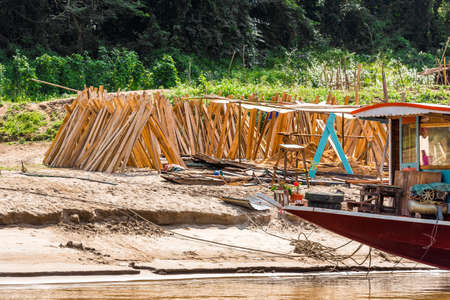 Wooden boards on the bank of the river Nam Khan in Louangphabang, Laos. Copy space for text Stock Photo