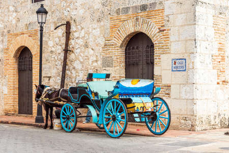Retro carriage with a horse on a city street in Santo Domingo, Dominican Republic.