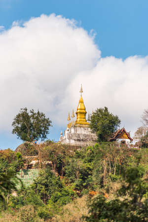 View of the Buddhist temple on the mountain, Louangphabang, Laos.
