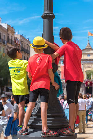 TARRAGONA, SPAIN - SEPTEMBER 17, 2017: Children on holiday Santa Tecla. Vertical Editorial
