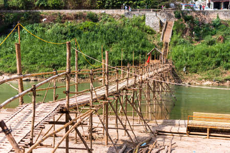 View of the bridge over the river Nam Khan river, Louangphabang, Laos.