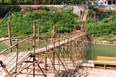 View of the bridge over the river Nam Khan river, Louangphabang, Laos.
