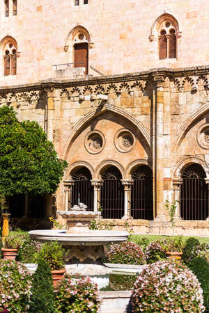 TARRAGONA, SPAIN - OCTOBER 4, 2017: View of the courtyard of the Tarragona Cathedral (Catholic cathedral) on a sunny day. Copy space for text. Vertical
