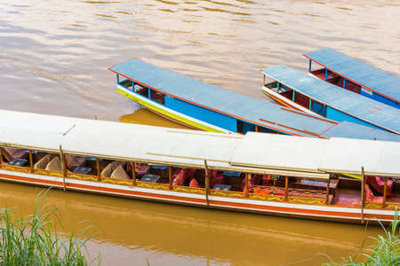 Boats near the bank of the river Nam Khan in Louangphabang, Laos. Close-up