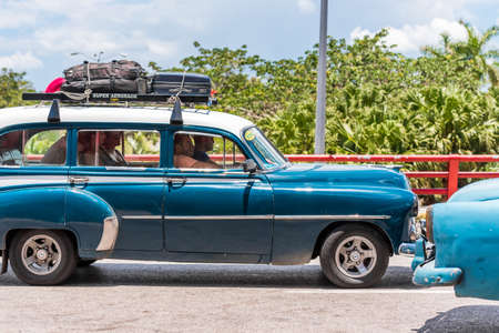 SANTO DOMINGO, DOMINICAN REPUBLIC - AUGUST 8, 2017: American blue retro car on city street. Copy space for text