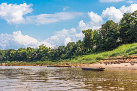 Boats near the bank of the river Nam Khan in Louangphabang, Laos.