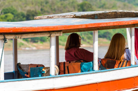 Tourists in a boat on the river Nam Khan in Louangphabang, Laos. Close-up Stock Photo