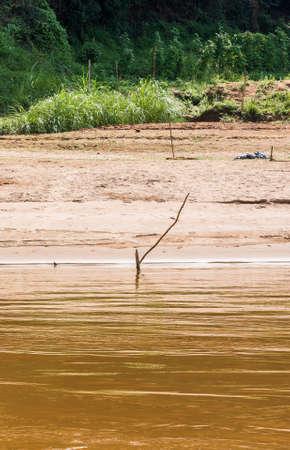 View of the river bank of the Nam Khan river, Louangphabang, Laos.