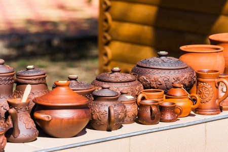 Many pottery are sold on the street in the city park, Goryachy Klyuch, Russia. Close-up