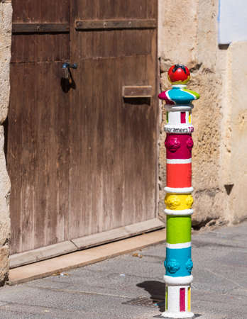Painted pillar in Tarragona, Catalunya, Spain. Copy space for text. Vertical