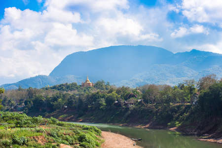 View of the Nam Khan river, Luang Prabang, Laos. Copy space for text. Stock Photo