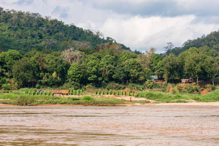 View of the Nam Khan river, Louangphabang, Laos. Copy space for text