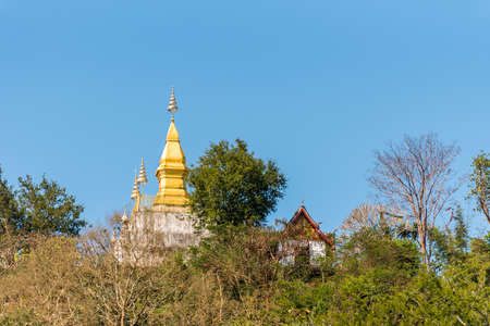 View of the Buddhist temple on the mountain, Louangphabang, Laos. Copy space for text