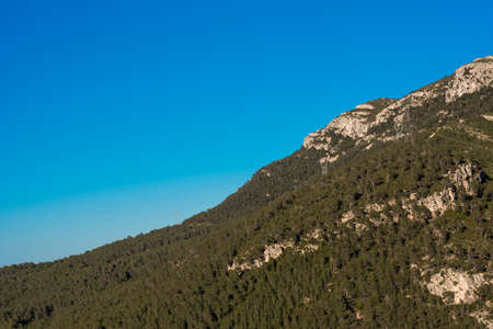 Mountains against the blue sky, Pratdip, Tarragona, Spain. Copy space for text