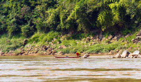 View of the landscape of the river Nam Khan, Luang Prabang, Laos. Copy space for text.