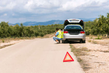 The Spanish landscape. The car broke down on the road, Tarragona, Catalunya, Spain. Copy space for text Stok Fotoğraf