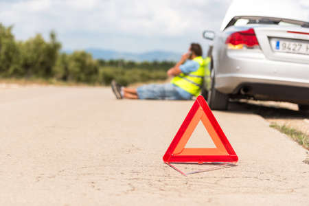 The car broke down on the road. Emergency sign close-up on the road, Tarragona, Catalunya, Spain