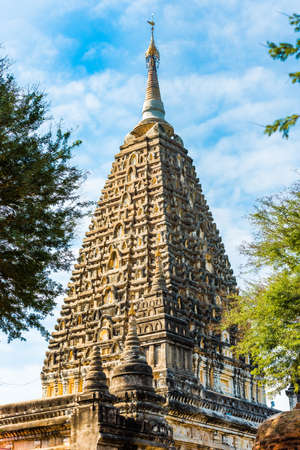 View of the buddhist temple in Bagan, Myanmar. Copy space for text. Vertical.