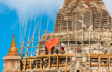 BAGAN, MYANMAR - DECEMBER 1, 2016: View of the facade of the building of Thatbyinnyu temple. Close-up