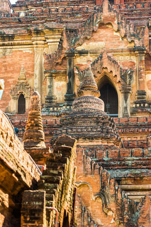 View of the facade of a building on a pagoda in Bagan, Myanmar. Close-up. Vertical