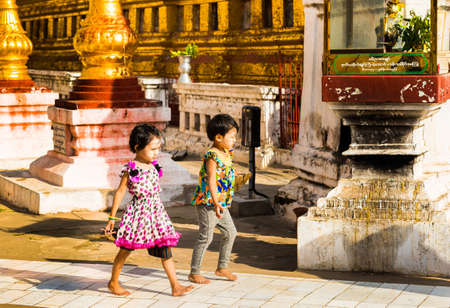 BAGAN, MYANMAR - DECEMBER 1, 2016: Two children in the temple. Copy space for text Editorial