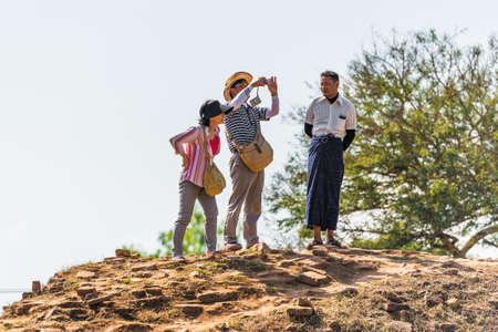 BAGAN, MYANMAR - DECEMBER 1, 2016: Tourists on the mountain. Copy space for text Editorial