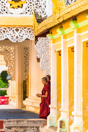 BAGAN, MYANMAR - DECEMBER 1, 2016: Monks near the temple. Copy space for text. Vertical Editorial