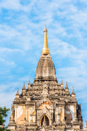 View of the facade of the building of the Shwegugyi temple in Bagan, Myanmar. Copy space for text. Vertical Editorial