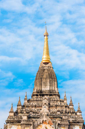 View of the facade of the building of the Shwegugyi temple in Bagan, Myanmar. Copy space for text. Vertical Stock Photo
