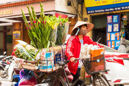 HANOI, VIETNAM - DECEMBER 16, 2016: A woman sells flowers in the local market. Close-up