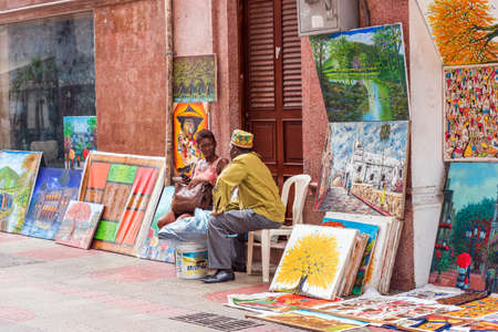SANTO DOMINGO, DOMINICAN REPUBLIC - AUGUST 8, 2017: Artists on a city street. Copy space for text