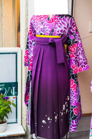 View of the purple kimono in the store, Kyoto, Japan. Close-up. Vertical