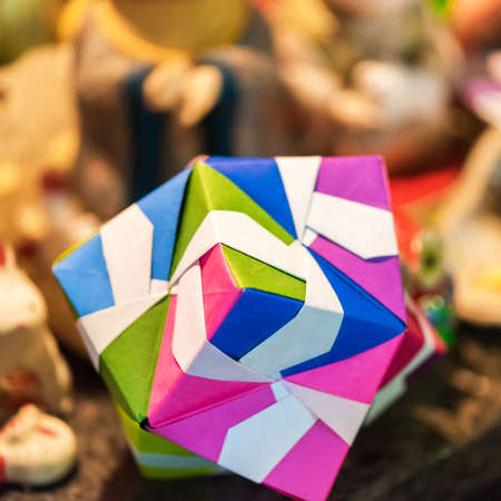 Multicolored cube in origami technique in Kyoto, Japan. Close-up.