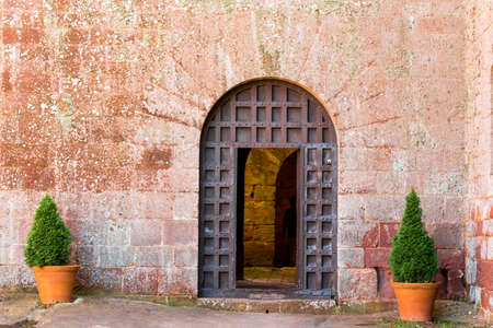 View of the old iron door of the monastery Escornalbou in Tarragona, Spain. Copy space for text Stock Photo