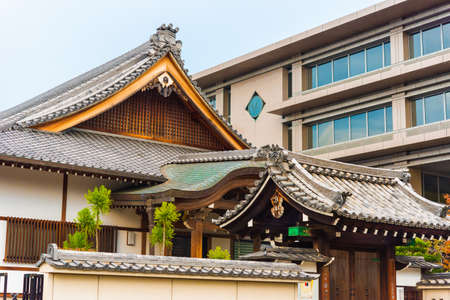 The building in the japanese style on a background of the sky, Kyoto, Japan. Copy space for text