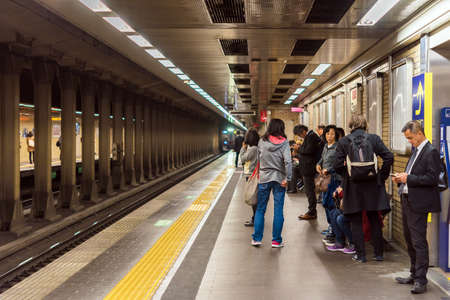 KYOTO, JAPAN - NOVEMBER 7, 2017: Group of people at the station in the metro. Copy space for text Editorial