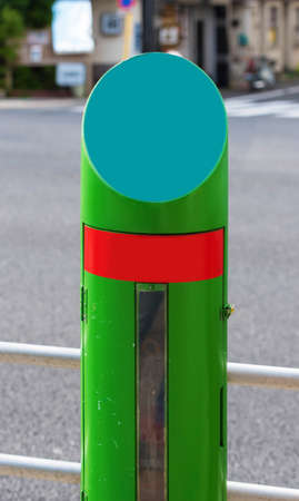 Green pillar on the city street, Tokyo, Japan. Vertical. Frame for text