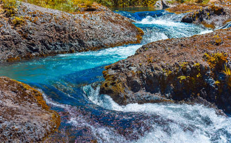 Waterfall in the national park Vicente Perez Rosales, Patagonia, Chile. With selective focus