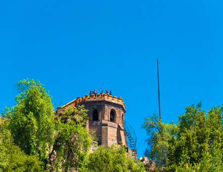 SANTIAGO, CHILE - JANUARY 10, 2018: View of the old lookout tower. Isolated on blue background. Copy space for text Redakční
