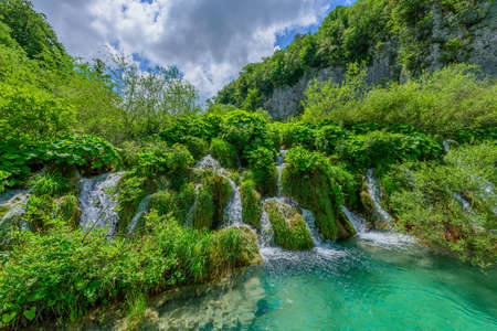 View of the waterfalls in the Plitvice Lakes National Park, Croatia. Copy space for text