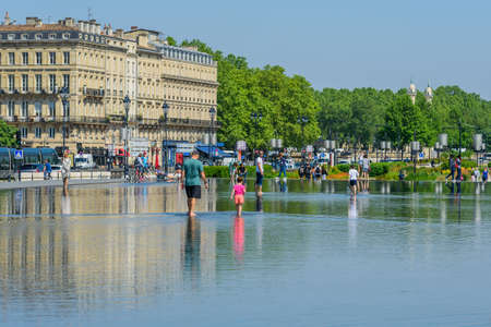 BORDEAUX, FRANCE - MAY 18, 2018: Crowd of people on the Exchange Square, Bordeaux, France. Copy space for text
