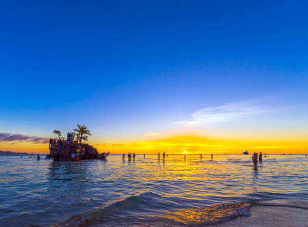 BORACAY, PHILIPPINES - FEBRUARY 28, 2018: Sunset on the sandy beach. Copy space for text Editorial