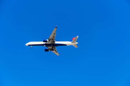 View of the plane against the blue sky, Hawaii, USA. Isolated on blue background. Copy space for text
