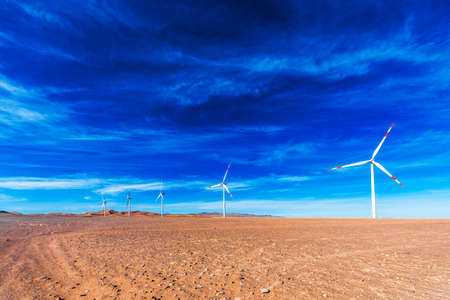 View of the desert and wind generators in the Atacama, Chile. Copy space for text