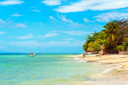 View of the sandy beach in Moalboal, Cebu, Philippines. Copy space for text Stock Photo