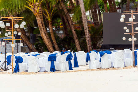 White chairs for a wedding ceremony on the beach, Boracay, Philippines. Copy space for text 스톡 콘텐츠