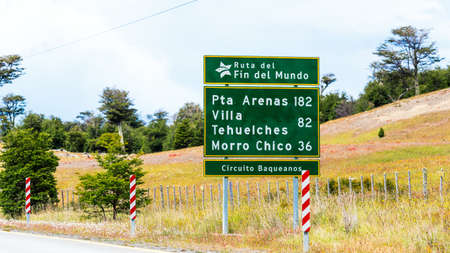 View of the road shield with the distance to the city Pta Arenas 182 km, Villa Tehuelches 82 km, Morro Chico 36 km, Patagonia, South America Stock Photo