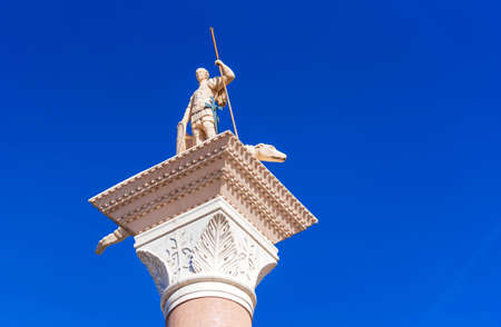 View of the Venetian statue of St. George and the dragon against the blue sky, Las Vegas, Nevada, USA. Isolated on blue background