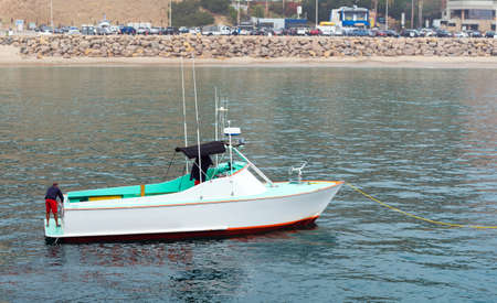 View of the white boat at the shore, Malibu, California, USA. Copy space for text