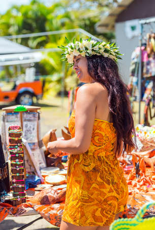 ARUTANGA, AITUTAKI, COOK ISLAND - SEPTEMBER 30, 2018: Girl with a white wreath of flowers. With selective focus. Vertical